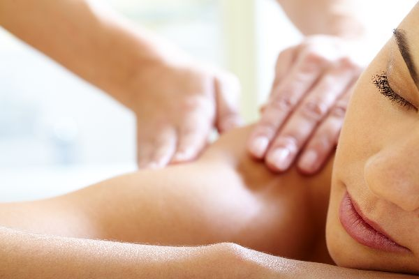 Woman receiving massage therapy in Longview